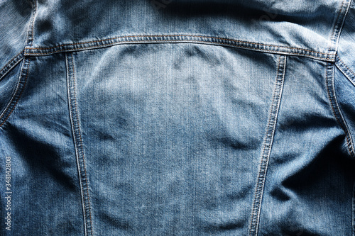 Photo Back side of a vintage blue jeans or denim jacket with copy space