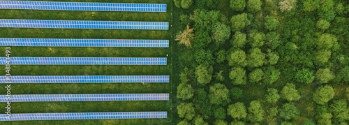 Aerial top down photo of solar panels PV modules mounted on flat roof photovolta Wallpaper Mural