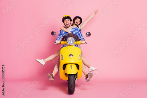 Fototapeta Portrait of nice attractive cheerful cheery glad carefree playful childish friends friendship driving vehicle without legs having fun fooling isolated on pink pastel color background obraz