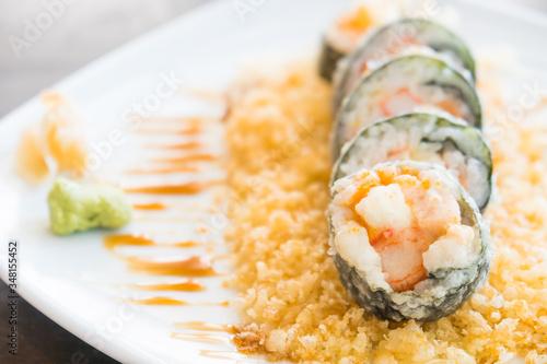 Fototapeta Selective focus point on Tempura sushi maki in white plate - Japanese food style obraz