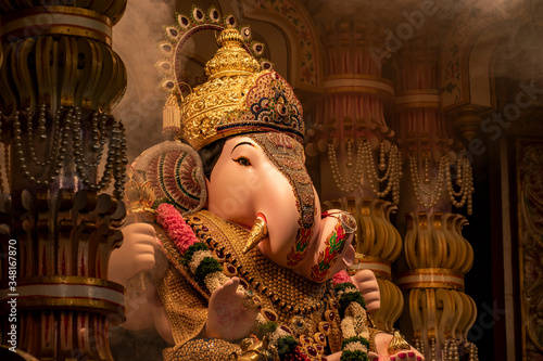 Fototapeta Dagdusheth Ganapati Idol at pune with golden jewellery and beautiful decoration