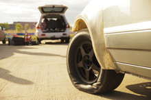 Crumpled Tyre At Racing Car At...