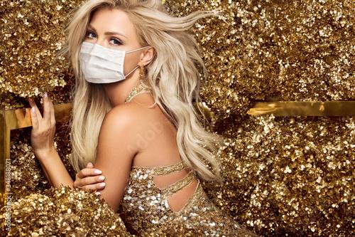 Slika na platnu Beautiful blonde woman in face mask in golden flowers garden