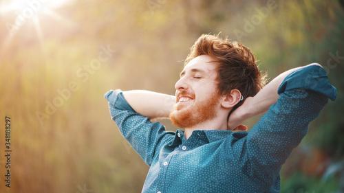 Obraz na plátně Happy hipster relaxing outdoors