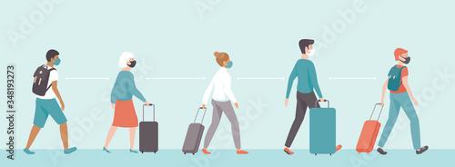 Fototapeta passengers wearing protective medical masks keeping distance in airport departure area.Travel during coronavirus COVID-19 disease outbreak. obraz