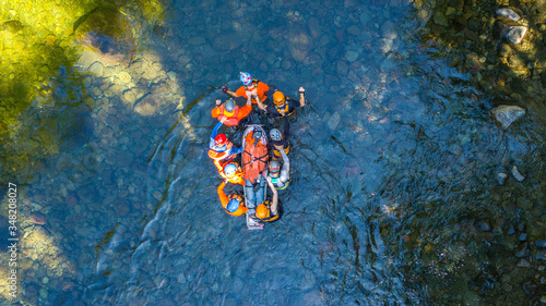 Obraz na plátně Search and Rescue Training Carrying Patient through a River