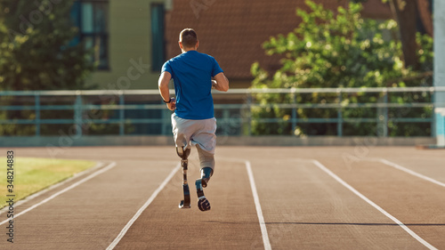 Fotografie, Obraz Athletic Disabled Fit Man with Prosthetic Running Blades is Training on a Outdoors Stadium on a Sunny Afternoon