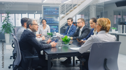 Group of Executives, Lawyers, Businesspeople and Investors Gather at the Table in Corporate Meeting Room to Discuss Business Opportunities, Company Growth Planning and Negotiation Strategy