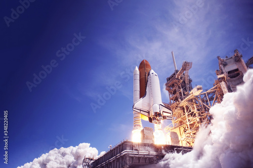 Photo The launch of the space shuttle against the sky, fire and smoke