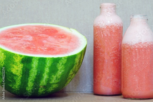 Glass bottles filled with freshly blended watermelon juice Canvas Print
