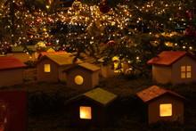 Illuminated Birdhouses With Christmas Decoration At Night