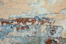 Texture Of Old Stucco On A Wall With Paint Residues With Cracks. Texture With An Unusual Pattern. Computer Desktop Wallpaper.