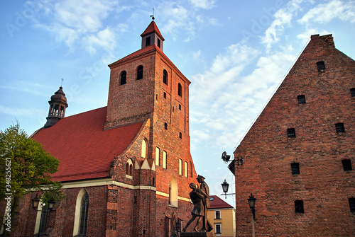 Fotografie, Tablou The facade of the gothic medieval Catholic Church  with belfry in Grudziadz