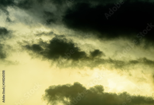 Dark and moody low altitude clouds at sunset. Canvas Print