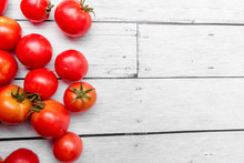 A Handful Of Fresh Tomatoes Sc...