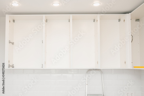 Obraz Kitchen installation, door cabinet front assembling furniture white carved - fototapety do salonu