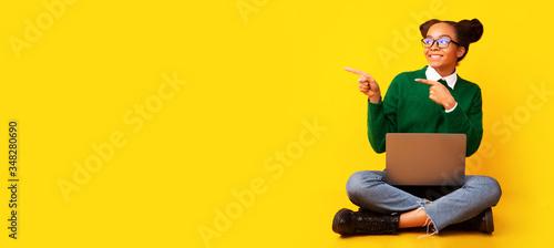 Obraz Happy afro teenager sitting on floor at studio - fototapety do salonu