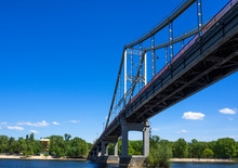 Low Angle View Of Bridge Over Dnieper River At Trukhanov Island Against Sky