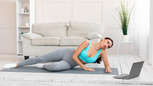Woman Training Watching Online Workout Video Training At Home, Panorama