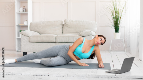 Canvas Print Woman Training Watching Online Workout Video Training At Home, Panorama