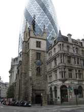 Low Angle View Of Church And 30 St Mary Axe Against Clear Sky
