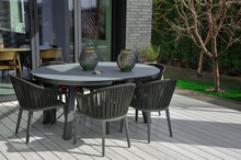 A Table And Four Chairs In The...