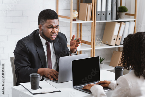 Young African American coworkers having argument at workplace, blank space Canvas Print