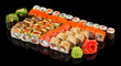 Assorted Sushi maki set with ginger and wasabi isolated on black background with reflection