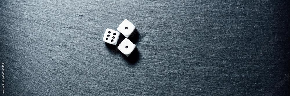 Fototapeta Black stone blackboard with playing dice on