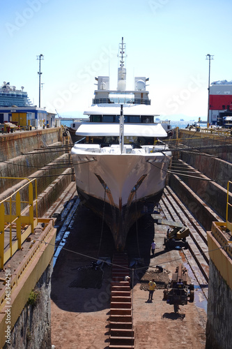Leinwand Poster Photo of ship repairs of yacht in hull in shipyard floating dry dock