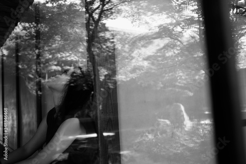 Fotografie, Tablou Reflection Of Disappointed Girl On Window