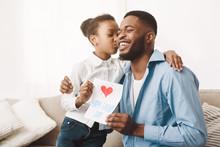 Cute Afro Daughter Kissing Dad...