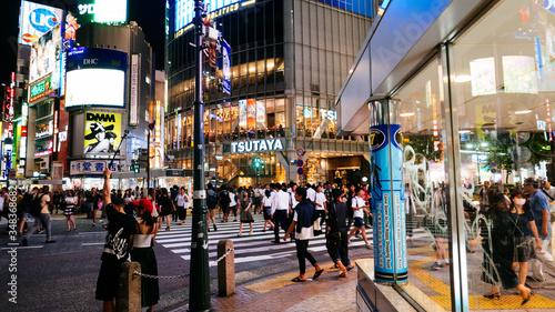 Fotografiet People Walking In Illuminated City At Night