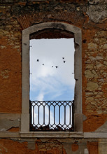 View Of Window Against Cloudy Sky