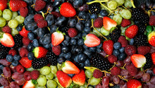 Summer Berries Food Background Full Frame Close Up With Strawberries, Blackberries, Blueberries, Red, Dark And Green Grapes On Black Marble.