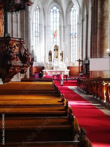 Rear View Of Woman Standing In Church Fototapeta