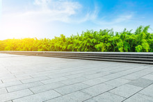 Empty Square Floor And Green Bamboo Forest Under The Blue Sky.