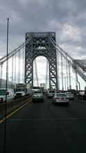 Cars On George Washington Bridge Against Cloudy Sky