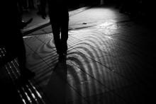 Silhouette Of People Walking On Sidewalk