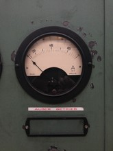 Close-up Of Machine Gauge With Text