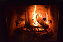 Firewood Burning In Fireplace