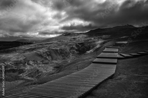Boardwalk On Mountain Against Cloudy Sky Fototapeta