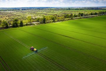 Farmland in Europe, tractor spraying pesticides
