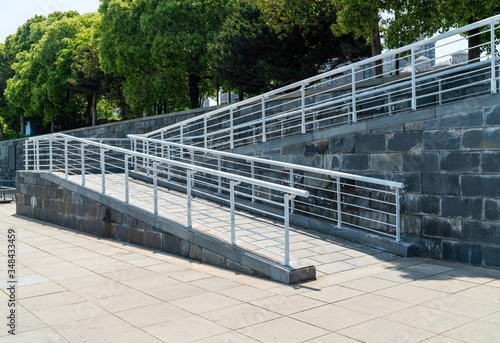 A wheelchair ramp, an inclined plane installed in addition to or instead of stai Fotobehang