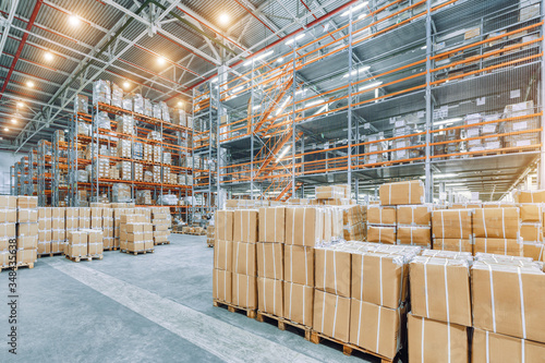 Canvastavla Large industrial warehouse with high racks