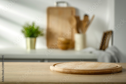 Wooden table in the kitchen with incoming morning sunlight with free space for a Canvas-taulu