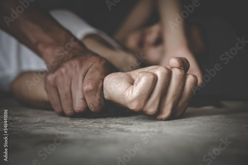 Photo Man's hand holding a woman hand for rape and sexual abuse,  Hands for rape and sexual abuse concept, Sexual abuse is a problem or Social issues concept