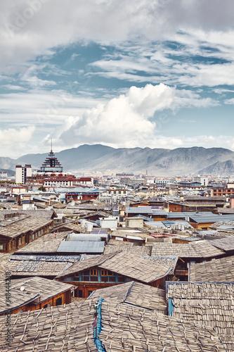 Roofs of Dukezong, Shangri La old town skyline, color toning applied, Diqing Tibetan Autonomous Prefecture, China Fototapeta