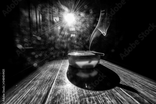 Smoke Emitting From Cigarette On Ashtray At Table Against Bright Sun Canvas Print