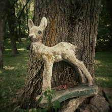 Abandoned Deer Figurine Leanin...